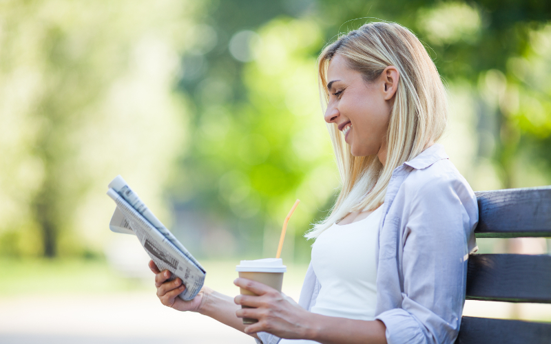A woman reading about a charity's good reputation for GDPR data protection